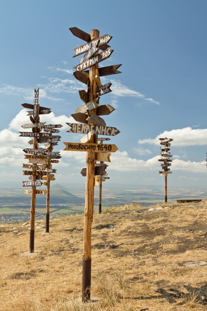 kavkaz: The pillars on top of the mountain Mashuk with signs for cities and countries names and distances