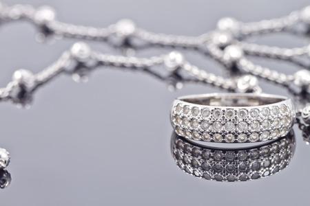 engagement silver ring with precious stones and fine silver chain Archivio Fotografico