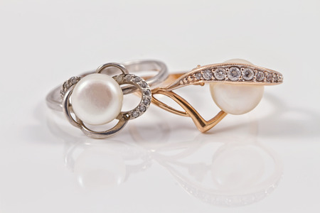 Elegant gold and silver ring with pearls lie next to each other Stok Fotoğraf - 44145429