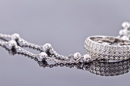engagement silver ring with precious stones and fine silver chain 스톡 콘텐츠