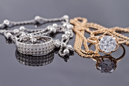 interlink: sets of gold and silver : ring and an elegant chain