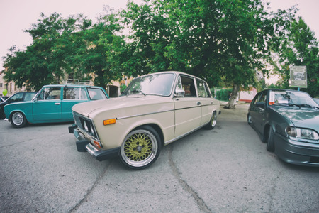 tuned: VOLGOGRAD, RUSSIA - SEPTEMBER 5: The old model VAZ-2106 in the new owners vision with modern accessories at the exhibition of tuned cars . September 5, 2015 in Volgograd, Russia. Editorial