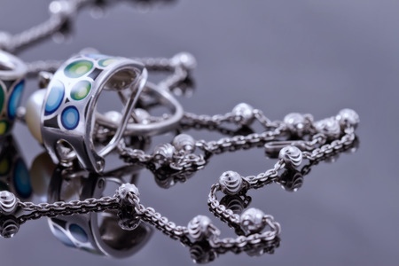 silver jewelry: Silver jewelry with colored enamel and elegant silver chain Stock Photo