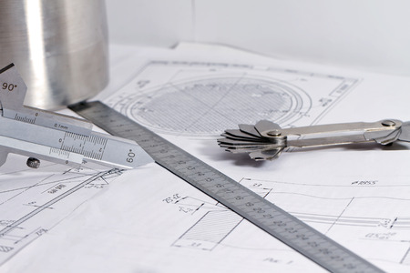 bevel: Templates for measuring the bevel edge during the preparation of the welded joints, measuring the height of the reinforcement bead and fillet weld leg are on the detail drawing Stock Photo