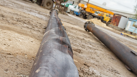 corrosion: Old pipe made of carbon steel is subjected to strain after work in aggressive environments