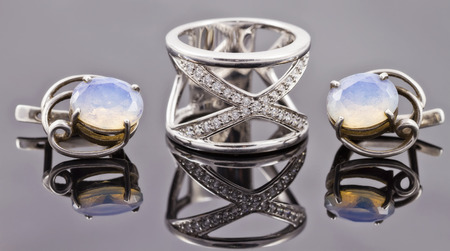 fine silver: set of fine silver jewelry : big ring and earrings with moonstone Stock Photo