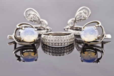 set of fine silver jewelry : ring and earrings with moonstone