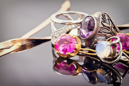 variety of jewelry made of precious metals: rings and earrings in gold and silver with inlays of different precious stones