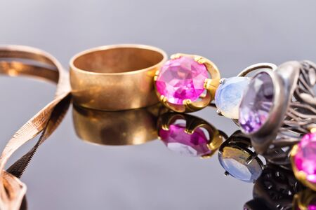 inlays: variety of jewelry made of precious metals: gold and silver rings with inlays of different precious stones