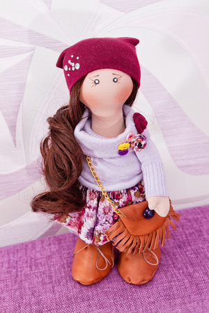 Collectible rag doll with a bag, in leather boots. The puppet natural hair for modeling a variety of hairstyles
