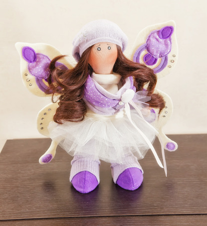 rag doll: Collectible rag doll with fairy wings. Doll decorated with rhinestones, she has wings and natural hair to create hairstyles