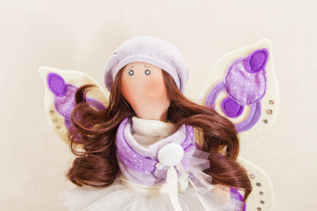 collectible: Collectible rag doll with fairy wings. Doll decorated with rhinestones, she has wings and natural hair to create hairstyles