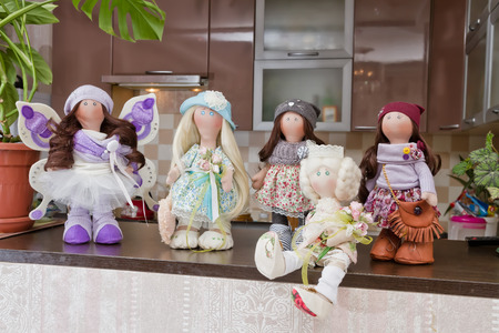 collectible: Collectible rag dolls handmade with natural hair exposed on the bar in the kitchen Stock Photo