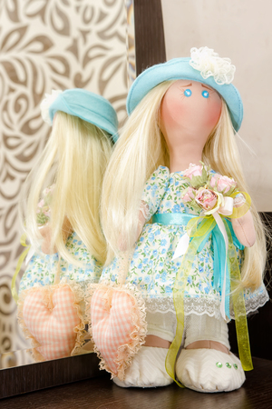Collectible rag doll handmade with natural hair in blue hat