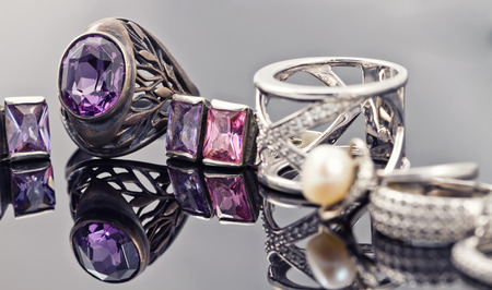 diamond rings: A set of silver jewelry from chains, rings, signet rings and bracelet with purple gemstones