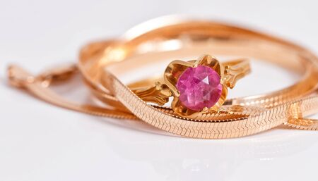 reflectance: Elegant gold chain and gold ring with ruby Stock Photo