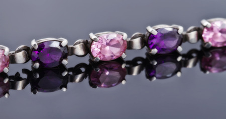 bead jewelry: silver bracelet with precious stones and purple color