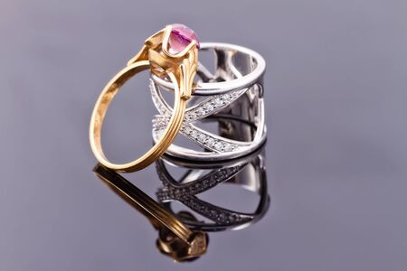 gold metal: Wide silver ring and a thin gold ring with ruby
