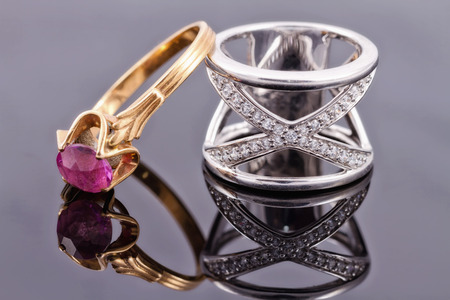 diamond rings: Wide silver ring and a thin gold ring with ruby