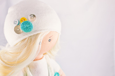 collectible: Collectible doll handmade - girl blonde girl with natural hair. Stock Photo