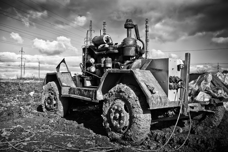 generate: The old Soviet diesel plant to generate electricity in the field is in the dirt. Black and white photo Stock Photo