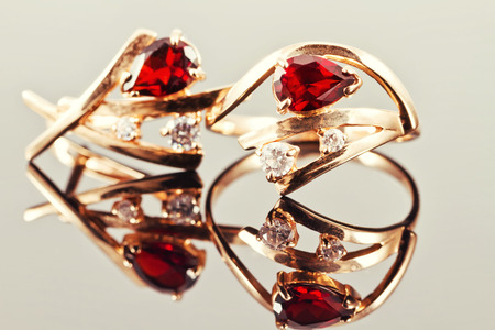 eras: gold earrings with rubies and alexandrites from different eras Stock Photo