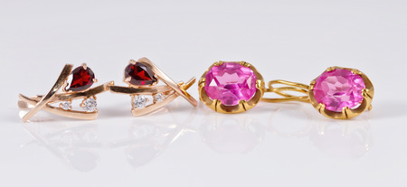 eras: two sets of gold earrings with rubies and alexandrites from different eras