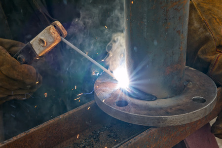flange: Flat welding flange to the pipe steel by a method of manual arc welding Stock Photo
