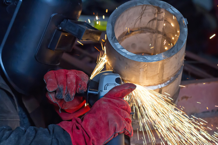 Mechanized cleaning of the root surface of the weld control sample of thick-walled stainless steel pipe Stock Photo