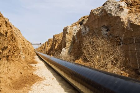 dug: pipeline is in the protective insulation laid on the bottom of the trench dug Stock Photo