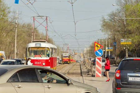 "public insurance: VOLGOGRAD - April 19: City trams of a route â""–11 are in a traffic jam in spasm with a road accident on the rails. April 19, 2016 in Volgograd, Russia."