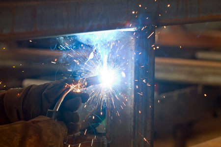 shielding: Sparks and jets of smoke when welding of steel structures semi-automatic welding in shielding gases