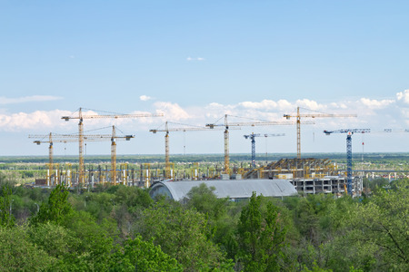 rotor: VOLGOGRAD - MAY 9: The construction of a new football stadium for the world Cup in 2018 on the site of the old ROTOR stadium. May 9, 2016 in Volgograd, Russia. Editorial