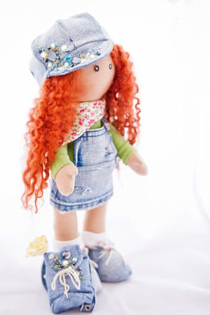 impish: Red-haired doll handmade dressed in jeans and with a backpack