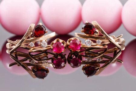 two sets of gold earrings with rubies and alexandrites from different eras