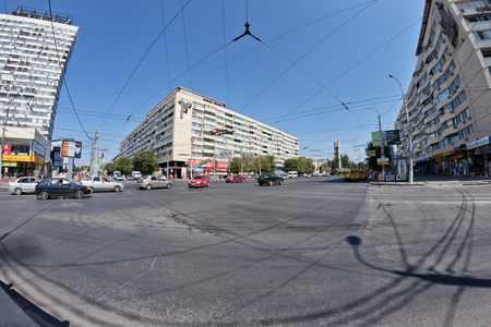 dangling: VOLGOGRAD, RUSSIA - AUGUST 22: Transport junction with a large number of dangling wires for movements of trolley buses. August 22, 2016 in Volgograd, Russia.