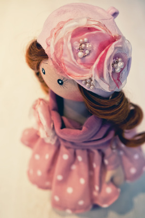 collectible: Collectible handmade doll in pink dress with white polka dots in the style of the 50s Stock Photo