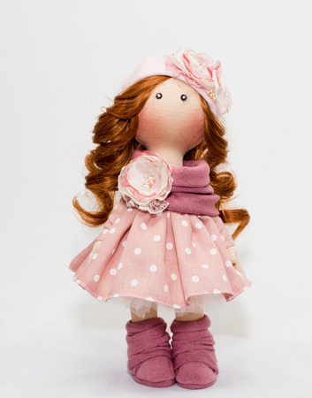 Collectible handmade doll in pink dress with white polka dots in the style of the 50s Foto de archivo