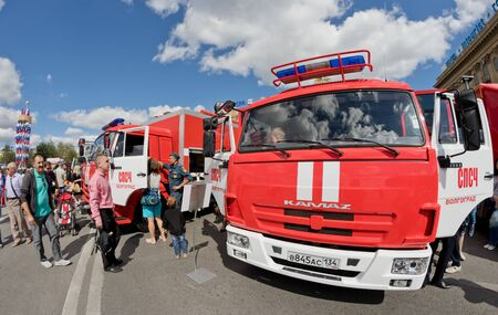 under fire: VOLGOGRAD - SEPTEMBER 10: A fire truck on KAMAZ chassis at the exhibition of fire equipment under the open sky. September 10, 2016 in Volgograd, Russia.