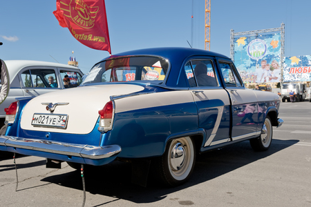 restored: VOLGOGRAD - SEPTEMBER 10: Restored and painted in shiny metallic blue Volga GAZ-21 at the exhibition of vintage cars. September 10, 2016 in Volgograd, Russia.