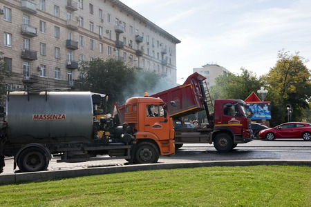 vibration machine: VOLGOGRAD - OCTOBER 6: Repair works on replacement of an asphalt covering of roads in the city centre. October 6, 2016 in Volgograd, Russia.