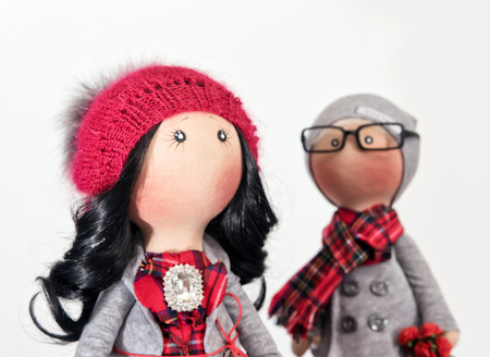 Handmade rag dolls with natural hair : a couple of hipsters in autumn clothes Stock Photo