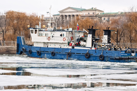VOLGOGRAD, RUSSIA - NOVEMBER 27: River tug floats on the navigable channel is already fettered by ice. November 27, 2016 in Volgograd, Russia. Editorial