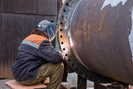 flange: Repair work on welded flange large chemical apparatus by manual arc welding with consumable electrode Stock Photo
