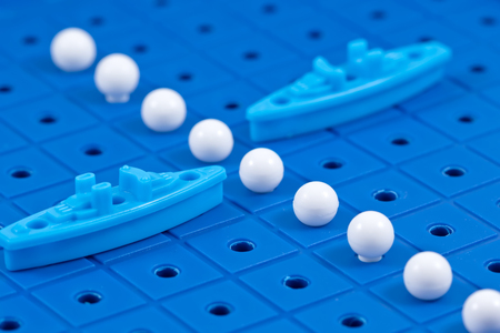 Toy war ships with missiles from Board games are in the imaginary Maritime boundary