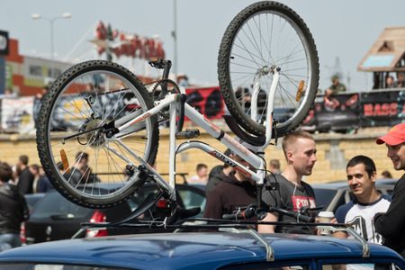 rack mount: VOLGOGRAD, RUSSIA - APRIL 29: mountain bike attached to the roof rack of the car of one of participants of competitions tuning and  car audio. April 29, 2017  in Volgograd, Russia.