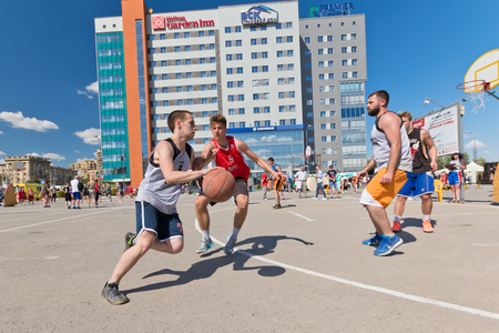 VOLGOGRAD, RUSSIA - MAY 27: Unidentified young people play in streetball on the open area located next to the dancing bridge, on May 27, 2017 in Volgograd, Russia.