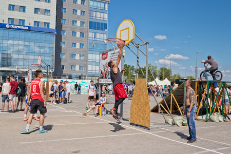 VOLGOGRAD - MAY 27: Shot from under the basket without resistance after a successful pass with the dribble in open competitions on streetball. May 27, 2017 in Volgograd, Russia.