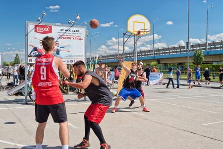 VOLGOGRAD, RUSSIA - MAY 27: Unidentified young people play in streetball on the open area located next to the dancing bridge. May 27, 2017 in Volgograd, Russia.