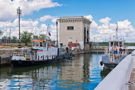 VOLGOGRAD - JUNE 19: Two small repair of the ship are locking in the waterlock of the dam a navigable channel. June 19, 2017 in Volgograd, Russia.